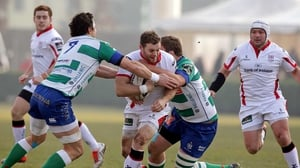 Ulster's Darren Cave tackled by Alessandro Zanni and Rupert Harden of Treviso