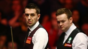 World champion Mark Selby (left) has been put out of the Masters by Shaun Murphy (right)