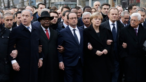 French President Francois Hollande links arms with other world leaders at the start of the Paris march