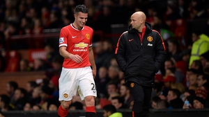 Robin van Persie grimaces as he exits the fray during Manchester United's loss to Southampton