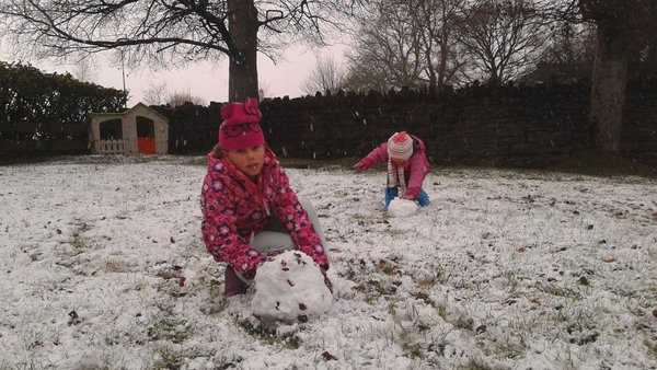 Children making a snowman in Carrick-on-Shannon, Co Leitrim (Pic: Carole Coleman)