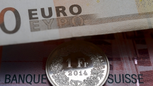 Euro trading near 11 year lows after shock move by Switzerland
