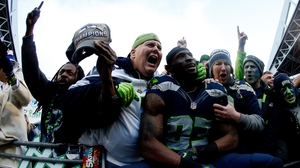 Ricardo Lockette of the Seattle Seahawks celebrates victory with Seahawks fans
