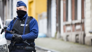 An armed Belgian officer patrols  a street in Verviers, one day after two suspected jihadists were killed in a police raid