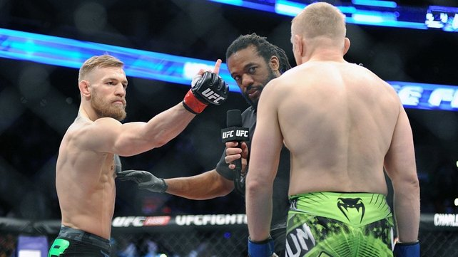 McGregor taunts Siver at the start of the fight
