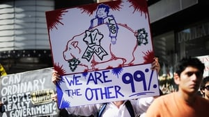 Protesters hold signs as they march to LA City Hall during a 2011 'Occupy Los Angeles' demonstration