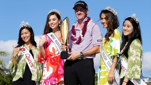 Jimmy Walker celebrates with the winner's trophy at Waialae Country Club
