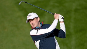 Peter Lawrie is just three shots off the lead in Qatar