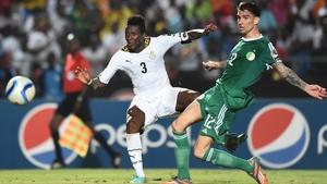 Asamoah Gyan (l) struck a late goal to win it for Ghana