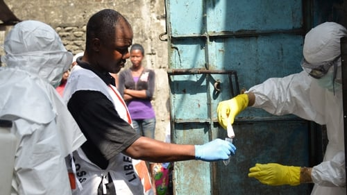 Red Cross workers in protective suits in Monrovia