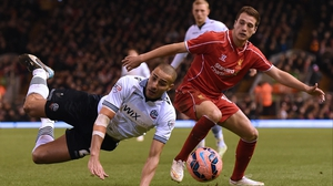 Darren Pratley of Bolton takes a tumble under a challenge from Javier Manquillo