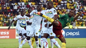 Cameroon's Aurelien Chedjou contorts himself to score