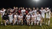 The Tyrone team celebrate winning