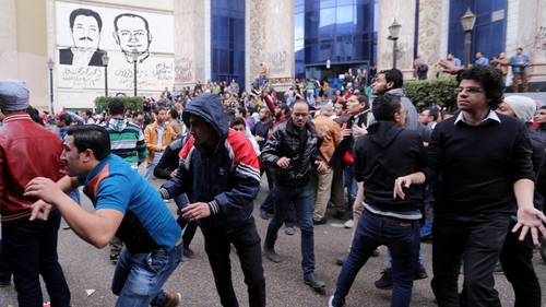 Police fired shotguns and tear gas to disperse hundreds of protesters in central Cairo