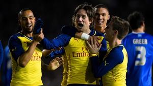 Tomas Rosicky celebrates with team-mates after scoring Arsenal third goal