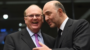 Michael Noonan with European Commissioner for Economic and Financial Affairs Pierre Moscovici in Brussels