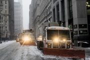 Snowploughs drive down Broadway during the winter storm in New York