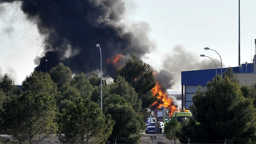 Smoke rises after the Greek F-16 aircraft crashed at Los Llanos air base in Albacete, eastern Spain
