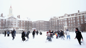 Students play football on the campus of Harvard University in Boston
