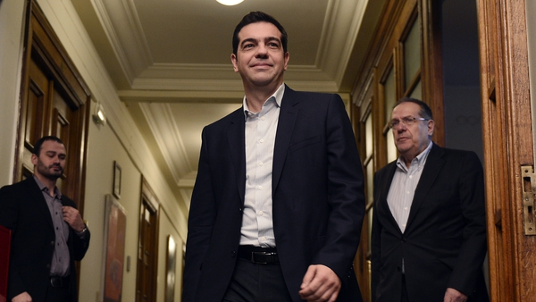 Alexis Tsipras arrives for the inaugural meeting of his cabinet in Athens this morning