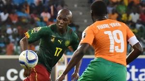 Cameroon's midfielder Stephane Mbia (L) challenges Ivory Coast midfielder Yaya Toure
