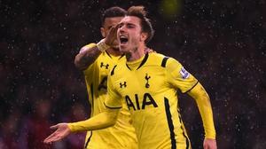 Tottenham's Christian Eriksen celebrates scoring from a free kick