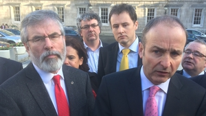 The Opposition spoke outside the Dáil after the walkout