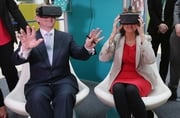 Enda Kenny and Joan Burton try on  virtual reality goggles as they launch the Action Plan for Jobs