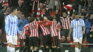 Athletic Bilbao players celebrate after forward Aritz Aduriz scored what proved to be the winner against Malaga