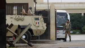 Suspected militants killed an army major and wounded six others at an army checkpoint in Rafah near the Gaza border