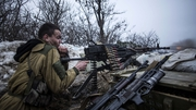 A pro-Russian separatist fires his machine gun towards an Ukrainian army positions near the eastern town of Debaltseve