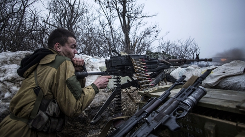 A pro-Russian separatist fires his machine gun towards Ukrainian army positions near Debaltseve