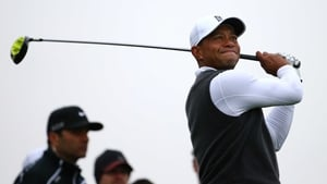 Tiger Woods grimaces after a drive from the tee at the Phoenix Open