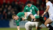 Keith Earls is tackled by England Saxons