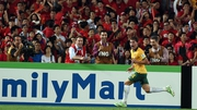 Australia's James Troisi celebrates scoring the winner in extra time