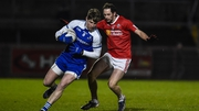 Tyrone's Ronan McNabb and Darren Hughes of Monaghan in action at Healy Park