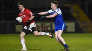 Tyrone's Mattie Donnelly escapes the challenge of Ryan McAnespie of Monaghan