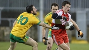 Derry's Kevin Johnston evades Donegal pair Mark McHugh and Michael Murphy