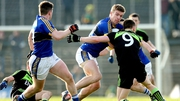 Kerry's Tommy Walsh tries to break clear from the attention of Mayo's Donal Vaughan