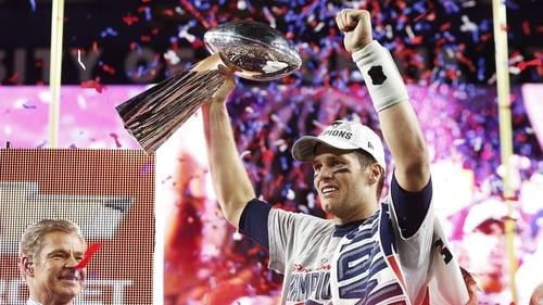 New England Patriots quarterback Tom Brady celebrates with the Vince Lombardi Trophy