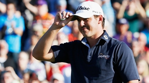Brooks Koepka acknowldeges the gallery on the 18th green after winning the Waste Management Phoenix Open