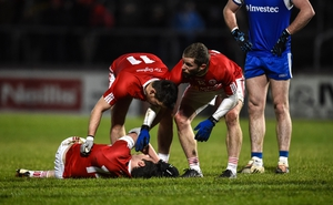 Tyrone's Sean Cavanagh is tended to by team mates after going down injured against Monaghan
