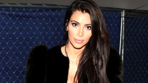 Kim Kardashian was held at gunpoint by five men posing as policemen