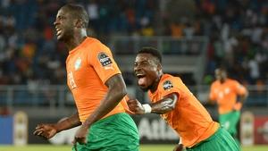 Yaya Toure celebrates with Serge Aurier (R) after scoring
