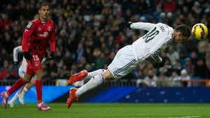 James Rodriguez scored a fine diving header before being forced off injured