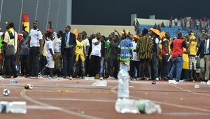 Ghana supporters try to get out of the stadium
