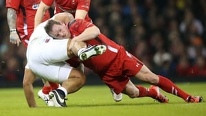 George North tackles England's Billy Vunipola in Cardiff last night