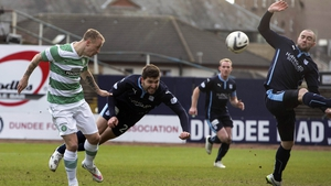 Leigh Griffiths scores the Bhoys' opener at Dens Park