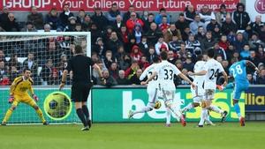 Jermain Defoe of Sunderland scores the opening goal at Swansea