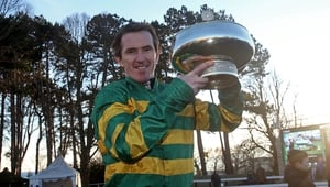 Tony McCoy poses with the Irish Hennessy Gold Cup after Carlingford Lough's victory